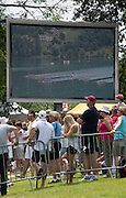 Aiguebelette, FRANCE.  Spectator waft the racing on the big screen at  the A  Finals at the  .  13:38:12  Sunday  22/06/2014. [Mandatory Credit; Peter Spurrier/Intersport-images]