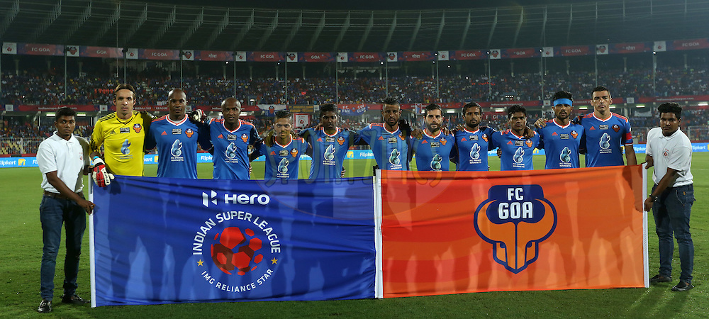 Team pose for the pix before the start of the  during match 9 of the Indian Super League (ISL) season 2  between FC Goa and Chennaiyin FC held at the Jawaharlal Nehru Stadium, Fatorda, Goa, India on the 11th October 2015.<br /> <br /> Photo by Sandeep Shetty / ISL/ SPORTZPICS