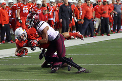 15 October 2016:  Ryan Neal takes down Spencer Schnell. NCAA FCS Football game between Southern Illinois Salukis and Illinois State Redbirds at Hancock Stadium in Normal IL (Photo by Alan Look)