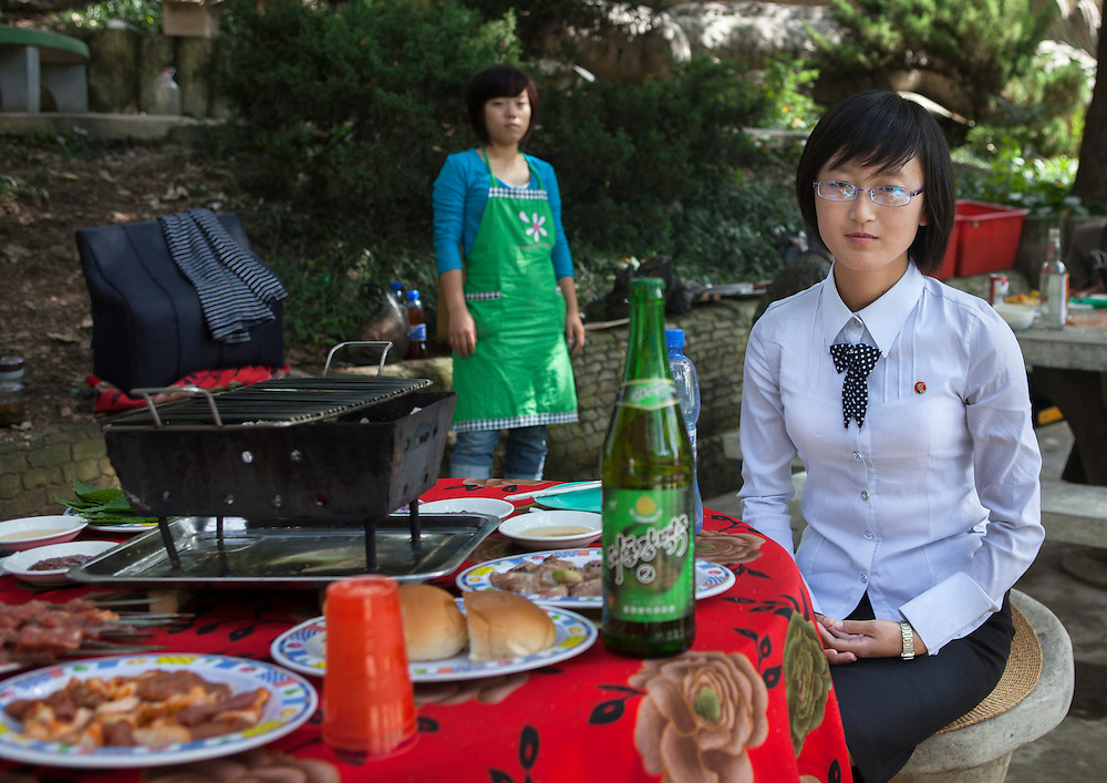 -Were you there during the times of famine?<br /> -We don't call it famine, we call it the &laquo;arduous march&raquo;.<br /> <br /> Young North Korean woman having picnic in a park in Pyongyang, North Korea.<br /> <br /> Miss Kim is 20. She lives in Pyongyang, North Korea's display window. She's studying English. First of her class, she was lucky enough to come with me during my 6th trip to North Korea as an assistant guide. She had never previously left Pyongyang. It was a unique opportunity for her to visit her own country and to get to meet and speak to a foreigner. She was shy at first, but became quite talkative as the days went on, and describe to me the everyday lives of young North Koreans. Without ever crossing over the Party line...<br /> <br /> Small chats between friends who will never meet again...<br /> <br /> Eric Lafforgue