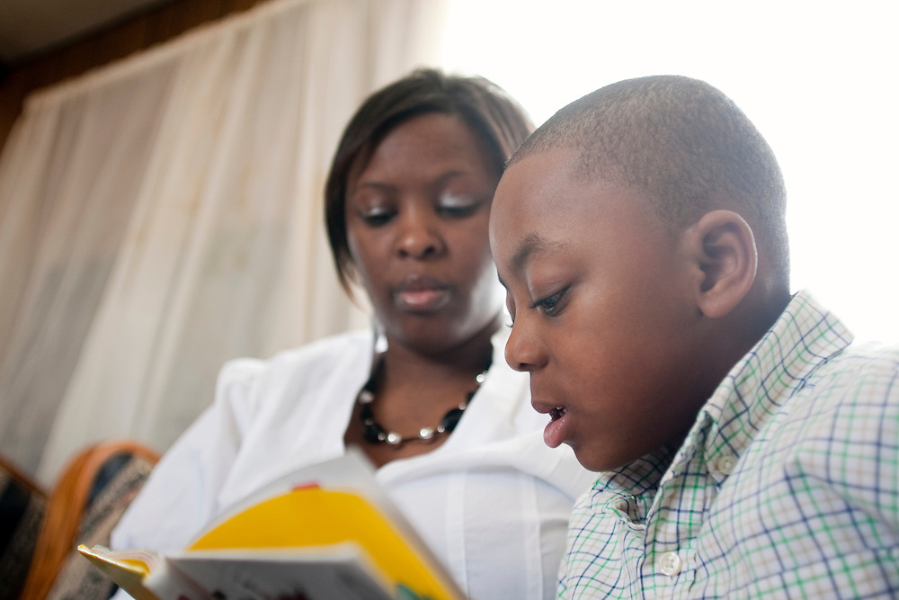 Latonia Best and her five-year-old son, Justin Cobb, read together inside their home near La Grange, N.C., on Sunday, Feb. 14, 2010. Justin recently had a bad earache and recovered without the aid of antibiotics, as advised by a doctor. ..D.L. Anderson for The Wall Street Journal.EAR