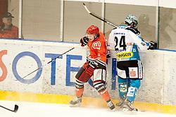 Andrej Zidan of Jesenice and Veideman Adrian of Linz during ice-hockey match between HK Acroni Jesenice and EHC Liwest Black Wings Linz in 43rd Round of EBEL league, on Januar 17, 2012 at Dvorana Podmezaklja, Jesenice, Slovenia. (Photo By Urban Urbanc / Sportida)