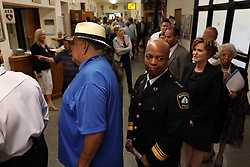 Newly-appointed Minneapolis Police Chief Medaria Arradondo stands between Clyde Bellecourt and Mayor Betsy Hodges as they wait for the start of a public swearing-in ceremony for Arradondo on Friday, Sept. 8, 2017, at the Sabathani Community Center in Minneapolis. (Photo by Anthony Souffle/Minneapolis Star Tribune/TNS/Sipa USA)