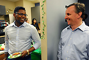 Insight Sourcing Group CEO Tom Beaty, right, talks to former Georgia Tech football player and Insight employee Tre Garrett during a St. Patrick's Day happy hour event at the firm's headquarters Friday, Feb. 27, 2015, in Norcross, Ga. The company is one of Atlanta's top businesses according to the firm's own employees. David Tulis / AJC Special