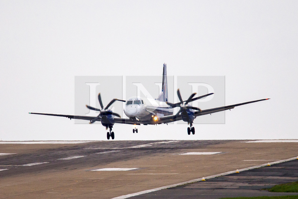 © Licensed to London News Pictures. 30/04/2018. Leeds UK. A Flybe flight from Southampton struggles to land in strong cross winds this morning at England's highest airport, Leeds Bradford International. Photo credit: Andrew McCaren/LNP
