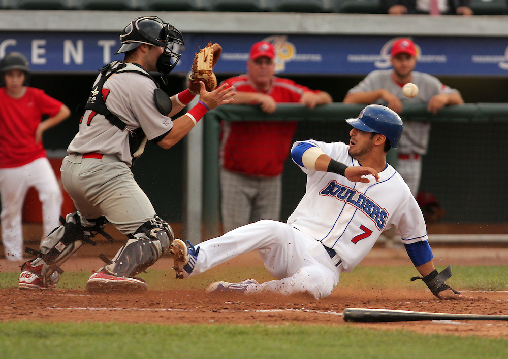 Xavier Mascareñas/The Journal News; Rockland Boulders' Ryan Mollica slides safely past the New Jersey Jackals catcher Chris Henderson to score the team's first run during the baseball game at Provident Bank Park in Pomona on July 5, 2012.
