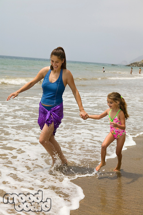 Mother and Daughter Getting Feet Wet