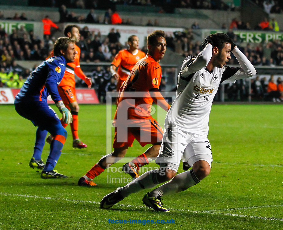 Picture by Mike  Griffiths/Focus Images Ltd +44 7766 223933<br /> 28/11/2013<br /> Kemy Agustien of Swansea City rues his missed chance against Valencia Club de F&uacute;tbol during the UEFA Europa League match at the Liberty Stadium, Swansea.