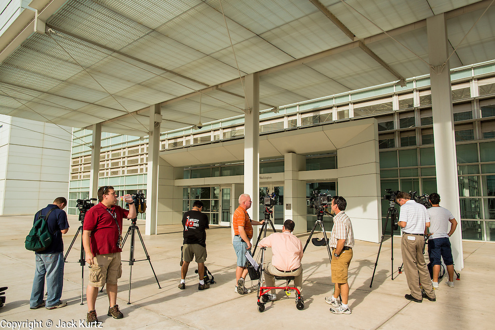 """19 JULY 2012 - PHOENIX, AZ:  The media in front of the US Courthouse in Phoenix on the first day of a class action lawsuit, Melendres v. Arpaio in Phoenix Thursday. The suit, brought by the ACLU and MALDEF in federal court against Maricopa County Sheriff Joe Arpaio, alleges a wide spread pattern of racial profiling during Arpaio's """"crime suppression sweeps"""" that targeted undocumented immigrants. U.S. District Judge Murray Snow granted the case class action status opening it up to all Latinos stopped by Maricopa County Sheriff's Office deputies during the crime sweeps. The case is being heard in Judge Snow's court.  PHOTO BY JACK KURTZ"""