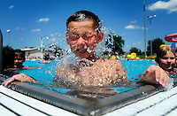 Sinjin Slater, 12, of Fond du Lac, shakes off the water as he plays at the pool at the Fond du Lac county fairgrounds. Wednesday, June 20, 2012. Patrick Flood/The Reporter.