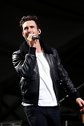03 May 2013. New Orleans, Louisiana,  USA. .New Orleans Jazz and Heritage Festival. Maroon 5..Adam Levine rocks JazzFest to the delight of the mud spattered crowd. .Photo; Charlie Varley.