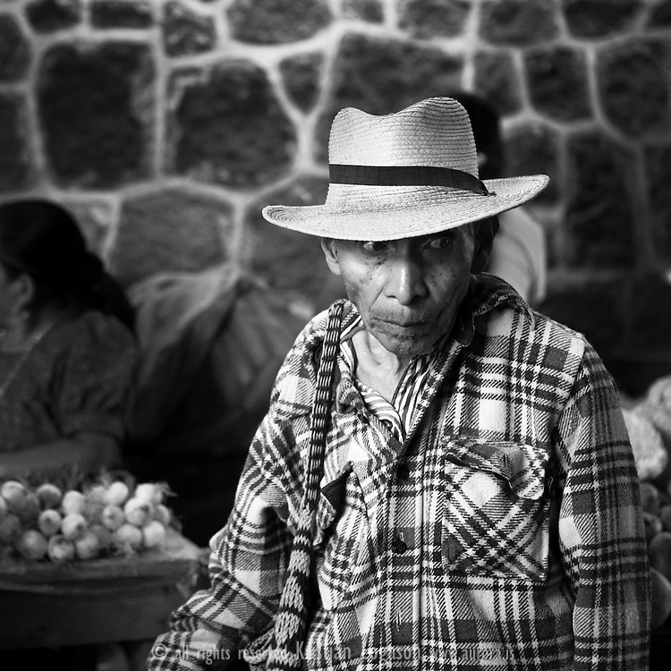 Man with hat shopping at the market in San Pedro de Lagoona by Lake Atitlán (Lago de Atitlán) in Guatemala