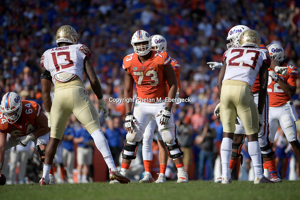 Florida offensive lineman Martez Ivey (73) lines up at the line of scrimmage during the second half of an NCAA college football game against Florida State Saturday, Nov. 25, 2017, in Gainesville, Fla. FSU won 38-22. (Photo by Phelan M. Ebenhack)