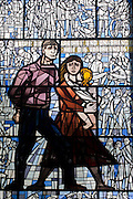 Stained glass showing families encarcerated in the Nazi Sachsenhausen concentration camp during WW2, now known as the Sachsenhausen Memorial and Museum. Sachsenhausen was a Nazi and Soviet concentration camp in Oranienburg, 35 kilometres (22 miles) north of Berlin, Germany, used primarily for political prisoners from 1936 to the end of the Third Reich in May 1945. After World War II, when Oranienburg was in the Soviet Occupation Zone, the structure was used as an NKVD special camp until 1950. Executions took place at Sachsenhausen, especially of Soviet prisoners of war. 30,000 inmates died there from exhaustion, disease, malnutrition, pneumonia, etc. The remaining buildings and grounds are now open to the public as a museum.