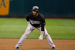 June 28, 2011; Oakland, CA, USA; Florida Marlins left fielder Emilio Bonifacio (1) leads off first base against the Oakland Athletics during the first inning at the O.co Coliseum.  Oakland defeated Florida 1-0.