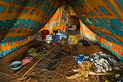 A young child sleeps in a tent set up in a spontaneous settlement near the village of Kpoto, Benin on Tuesday October 26, 2010. Almost all of the village's 1500 people have moved to a location near the local church, located about 500 meters away, where they now live in basic shelters. Some tents were donated by the Benin government, but they aren't waterproof and don't provide adequate shelter with the rainy season still going strong.
