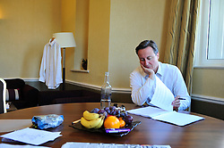 Leader of the Conservative Party David Cameron going through his speech in the Conference Hotel a few hours before he is due to go on stage to deliver it to the Conservative Party Conference, Manchester, UK, Thursday, October 8, 2009. Photo By Andrew Parsons / i-Images.