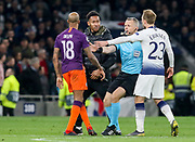 Pitch invader approaches Manchester City midfielder Fabian Delph (18) with Referee Bjorn Kuipers from Holland (NED) seperating during the Champions League Quarter-Final 1st leg between Tottenham Hotspur and Manchester City at Tottenham Hotspur Stadium, London, United Kingdom on 9 April 2019.