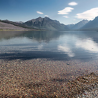 Early morning view of the mountains from Lake McDonald, with fine reflections! Glacier National Park, Montana