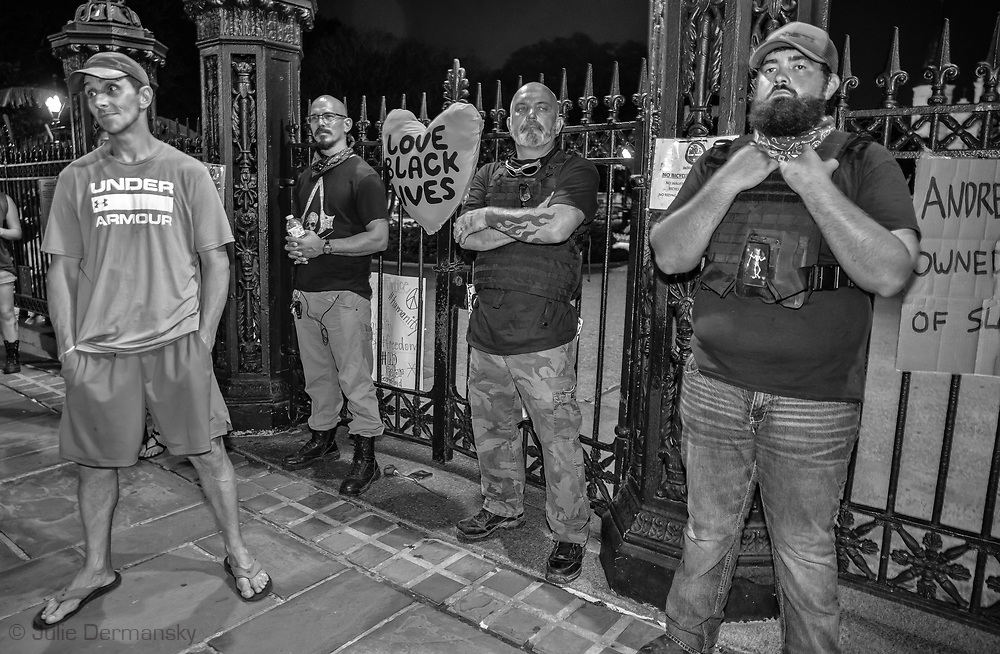 A small group of white supramists stoot in fron to  Jackson Square in New Orleans on June 5, 2020 claiming to be there to protect the Andrew Jackson monumet in the locked park, on the seventh day of protests over the police killing of George Floyd in Minneapolis on May 25.