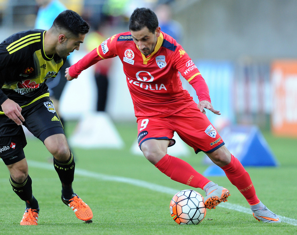 Adelaide United's Sergio Cirio, right, plays inside Phoenix's Justin Gulley in the A-League football match at Westpac Stadium, Wellington, New Zealand, Friday, November 13, 2015. Credit:SNPA / Ross Setford