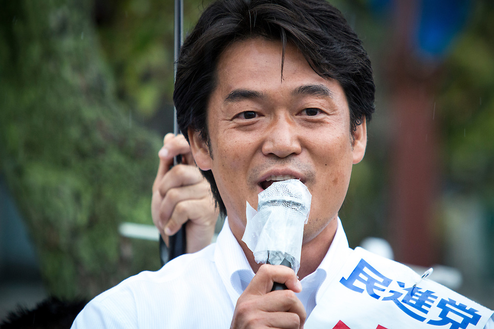 CHIBA, JAPAN - JULY 9 :  Hiroyuki Konishi, a candidate from Democratic Party of Japan (DPJ) delivers campaign speech during the 2016 Upper House election campaign outside of Kaihin Makuhari Station in Chiba, Japan on July 9, 2016. Tomorrow, July 10, 2016 will be the first Upper house election nation-wide in Japan that 18 years old can vote after government law changes its voting age from 20 years old to 18 years old. (Photo by Richard Atrero de Guzman/NUR Photo)