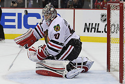 Mar 27; Newark, NJ, USA; Chicago Blackhawks goalie Corey Crawford (50) makes a save during the second period of their game against the New Jersey Devils at the Prudential Center.