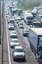 &copy; Licensed to London News Pictures. 18/04/2019.<br /> Dartford,UK. The Easter getaway traffic has started today with families setting out for a bank holiday weekend break. Very heavy traffic anti-clockwise causing miles of queues on the M25 near Dartford in Kent. Photo credit: Grant Falvey/LNP