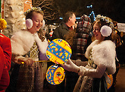 """""""Swiss Miss girls"""" Aspen Sims and Torrey Turner hold their lanterns before the annual Christkindlmarket lantern parade and Christmas tree lighting ceremony at This Is The Place Heritage Park, Thursday, Nov. 29, 2012."""