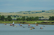 A group of canoes arrives in a protest camp that sprang up to demonstrate against the Energy Transfer Partners' Dakota Access oil pipeline near the Standing Rock Sioux reservation in Cannon Ball, North Dakota. The canoe flotilla had representatives of tribes from the across the Pacific Northwest and navigated the Missouri River from Bismarck to Cannon Ball to show their support.