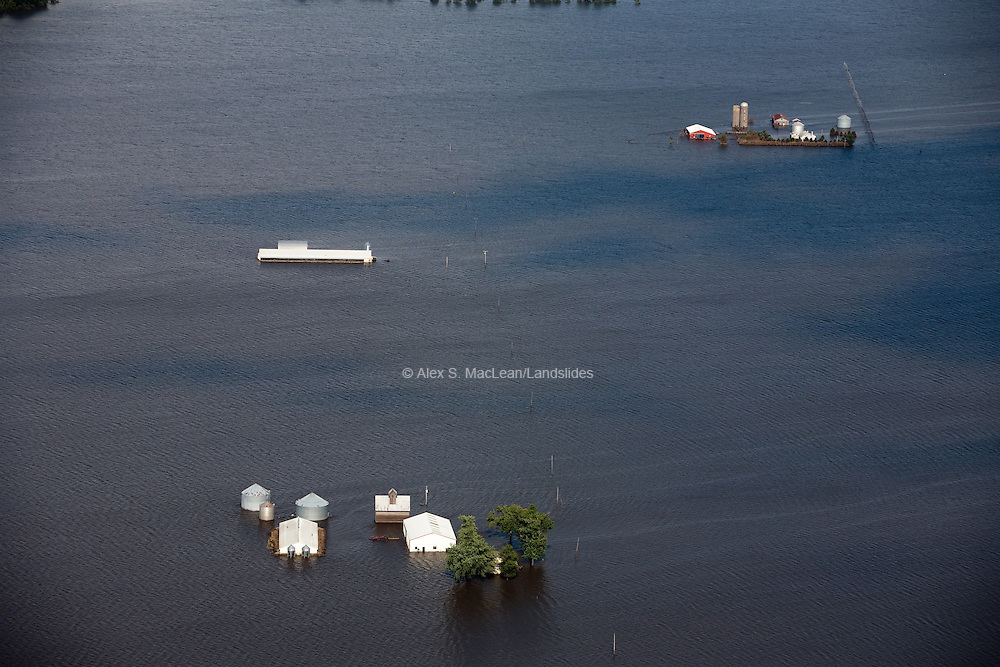 Flood of the upper Mississippi River in June 2008; the flood resulted in thousands of dollars of damage, leaving mold and debris in almost every home and business;  especially local farms.