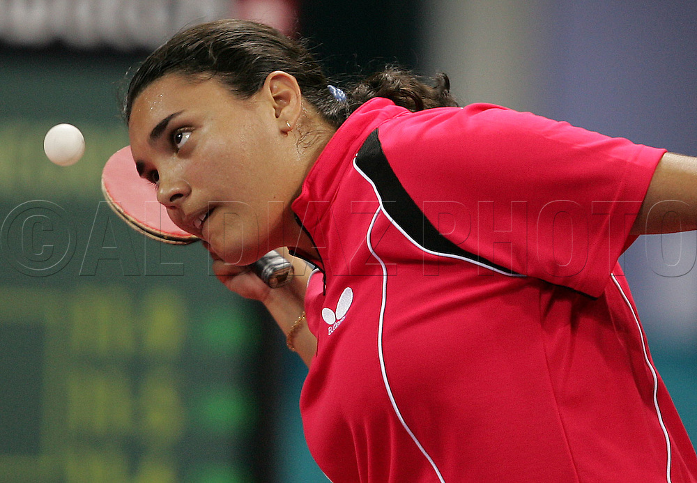 8/14/04 --Al Diaz/Miami Herald/KRT--Athens, Greece--Table tennis at Galasti Olympic Hall during the Athens 2004 Olympic Games. Here, Fabiola Ramos of Venezuela loses to Negrisoli of Italy on Saturday in round one of women's singles.
