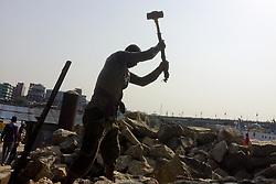 April 27, 2018 - Dhaka, Bangladesh - A stone breaking worker is working in a field in a heated mid-summer day on April 27th 2018, in Dhaka, Bangladesh. (Credit Image: © Khandaker Azizur Rahman Sumon/NurPhoto via ZUMA Press)