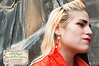 """Flower feather photo jewelry earrings by Star Nigro<br /> <br /> Materials: orange flower photo, 22K gold accents, orange feathers, swarovski crystals, sterling silver earring hooks<br /> <br /> size: 2"""" x 1/8""""<br /> <br /> price: $64.00<br /> <br /> photo jewelry: Star Nigro<br /> photo by: Star Nigro<br /> <br /> model:Palma Latorre artist/fx artist<br /> gorgeousfrankenfx.wixsite.com/gffx<br /> https://www.facebook.com/GF.effects/"""