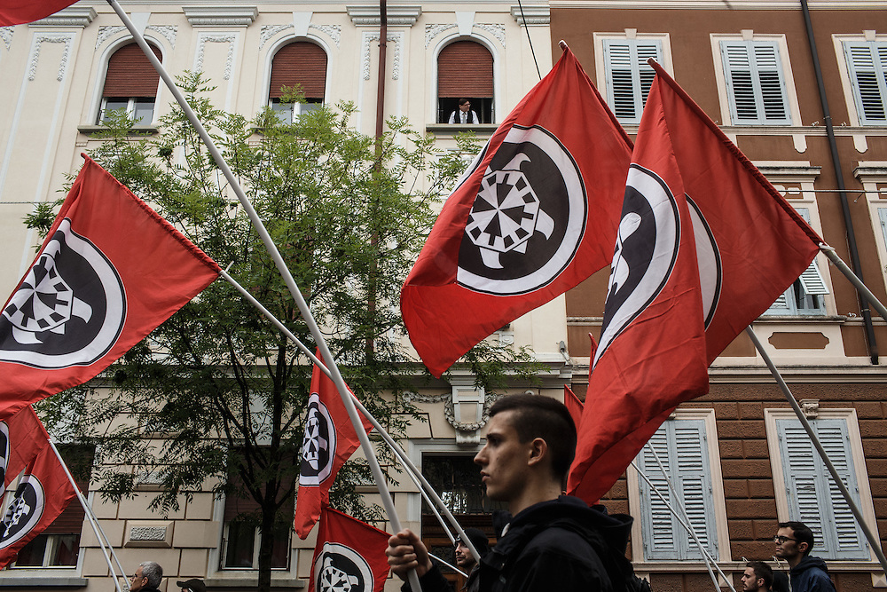 23.5.2015, Gorizia, Italy<br /> <br /> Rally of neofascists from whole Italy in Gorizia at 100. anniversary of entry of Italy into the 1st World War organised by fascistic movement Casa Pound. All fascist groups brought soil from different parts of Italy to celebrate 1. WW. They marched in silence, but everyone who was present at rally could feel dim and creepy atmosphere.<br />  After the end of 1. World War Italy litteraly enslaved, tortured and changed names of Slovenian people to Italian names in Primorska region. On  July 13. 1920 Italian fascists burned down Slovenian National home in Trieste and about 21 different buildings, offices, apartments, banks, printing offices, warehouses and pubs. Interresting was that, that official government didn`t arrest none of raging demonstrants. After that fascists(from 1920 to 1941 killed almost 40 000 Slovenes in Primorska region. Italy even today denies genocide over Slovene population in Primorska region and tries to hide its role during 2. World War by silence about this part of history in their history books. That`s the main reason why in Italy young people again embrace fascits ideology.