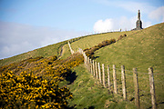 BORTH, WALES, UK 16TH MARCH 2020 - Ceredigion coastal footpath with stone cross monument on a hill in Borth, Wales, UK.