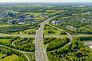 Nederland, Utrecht, Utrecht, 13-05-2019; Knooppunt Rijnsweerd. Kruising A28 en A27, klavertribune. Utrecht Science Park, voorheen De Uithof, linksboven.<br /> Rijnsweerd junction, east of Utrecht<br /> <br /> luchtfoto (toeslag op standard tarieven);<br /> aerial photo (additional fee required);<br /> copyright foto/photo Siebe Swart