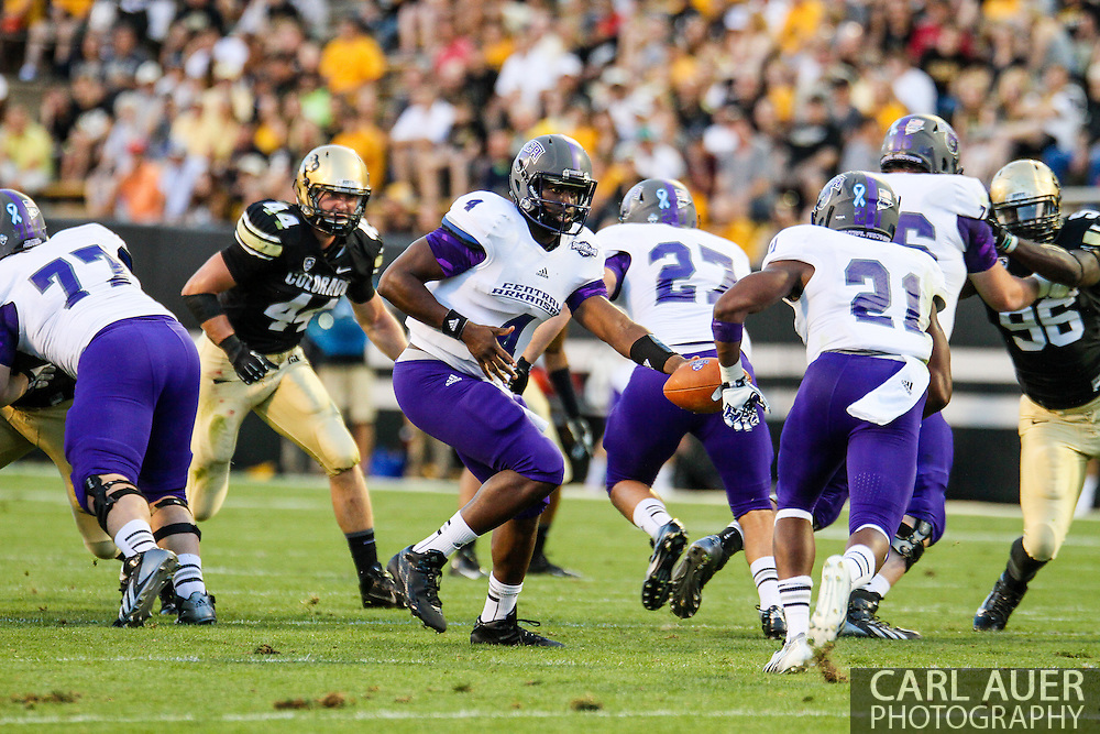 September 7th, 2013 - University of Central Arkansas Bears senior quarterback Wynrick Smothers (4) hands the ball off to junior running back Willie Matthews (21) in first half action of the NCAA football game between the University of Central Arkansas Bears and the University of Colorado Buffaloes at Folsom Field in Boulder, CO