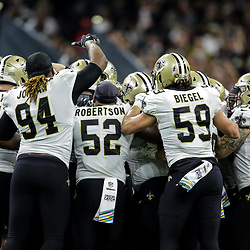 Oct 8, 2018; New Orleans, LA, USA; New Orleans Saints quarterback Drew Brees (9) celebrates with teammates after setting the NFL record for yards passing yardage on a 62 yard touchdown pass to wide receiver Tre'Quan Smith (not pictured) during the second quarter against the Washington Redskins at the Mercedes-Benz Superdome.
