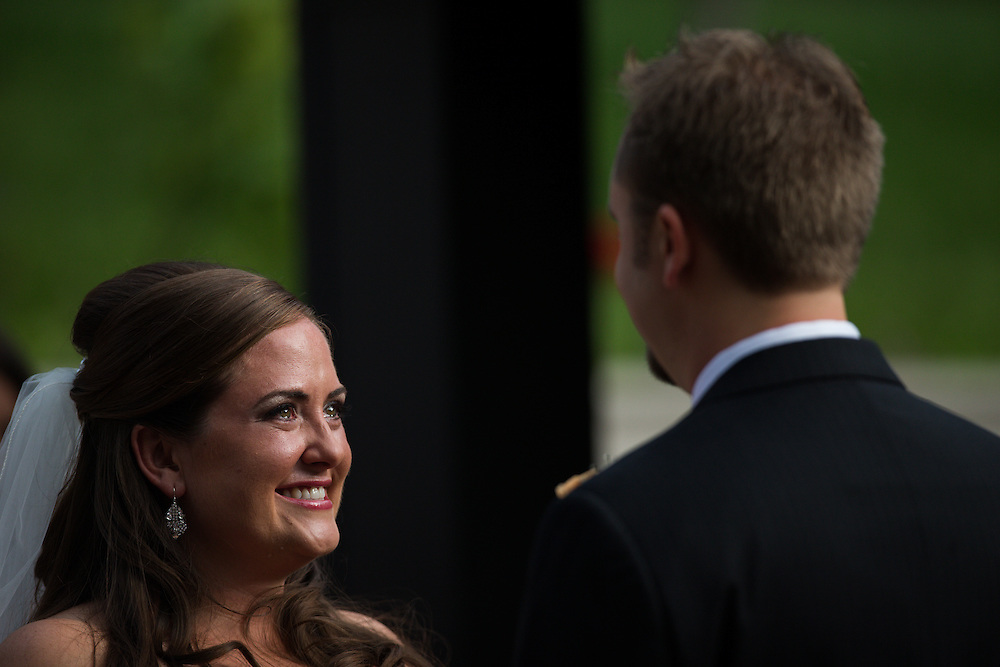 Amy Trollinger and Neil Hebbert are married at the University of Denver in Denver, Saturday, June 15, 2013.