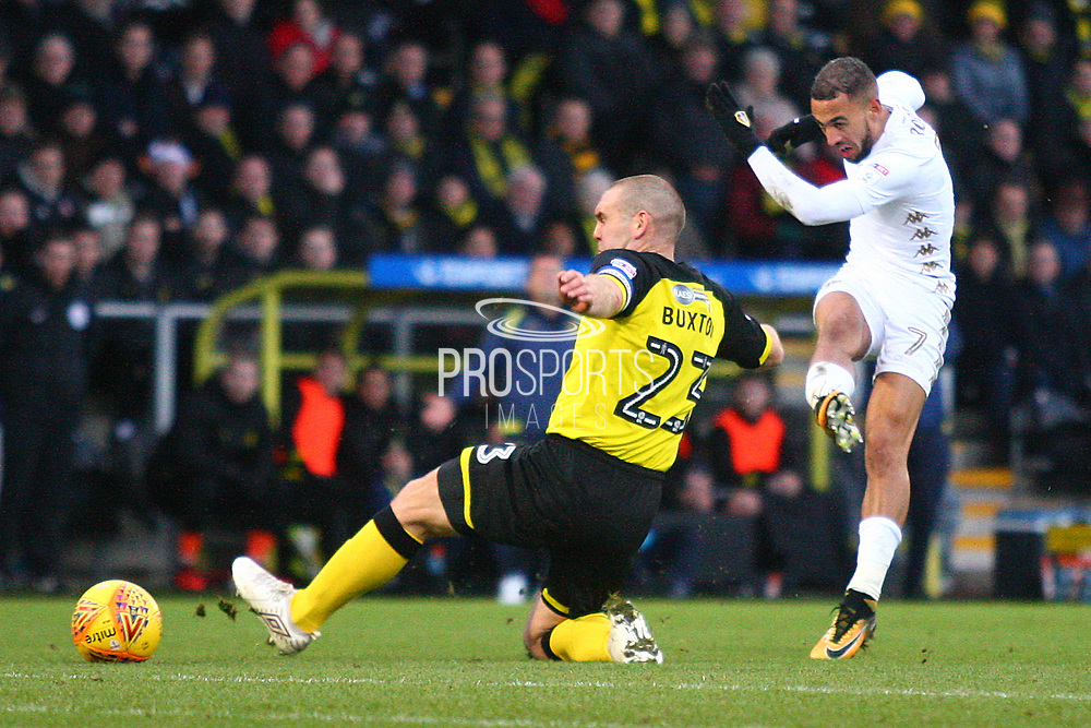 Leeds Kemar Roofe shoots past Burton Albion's Jake Buxton during the EFL Sky Bet Championship match between Burton Albion and Leeds United at the Pirelli Stadium, Burton upon Trent, England on 26 December 2017. Photo by John Potts.