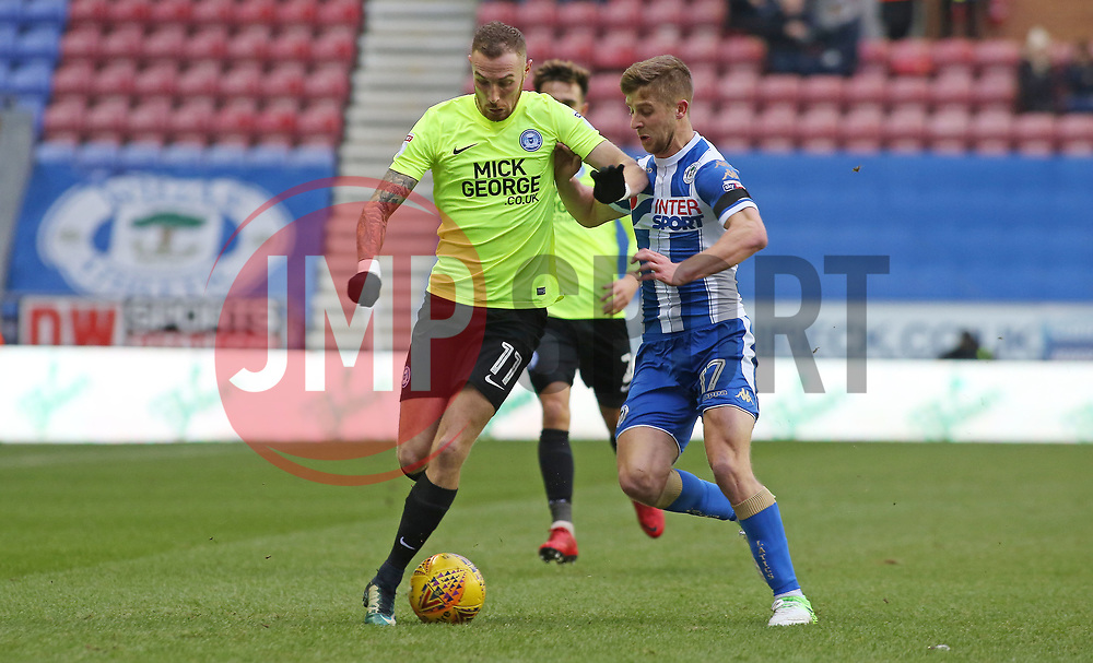 Marcus Maddison of Peterborough United in action with Michael Jacobs of Wigan Athletic - Mandatory by-line: Joe Dent/JMP - 13/01/2018 - FOOTBALL - DW Stadium - Wigan, England - Wigan Athletic v Peterborough United - Sky Bet League One