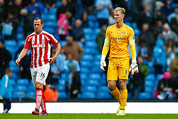 Joe Hart of Manchester City looks dejected as Charlie Adam of Stoke looks on after Stoke City win the match 0-1 - Photo mandatory by-line: Rogan Thomson/JMP - 07966 386802 - 30/08/2014 - SPORT - FOOTBALL - Manchester, England - Etihad Stadium - Manchester City v Stoke City - Barclays Premier League.