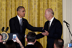 October 12, 2016 - Washington, District of Columbia, United States of America - United States President Barack Obama (L) shakes hands with Vice President Joe Biden during a reception for Hispanic Heritage Month in the East Room of the White House on October 12, 2016 in Washington, DC. .Credit: Olivier Douliery / Pool via CNP (Credit Image: © Olivier Douliery/CNP via ZUMA Wire)