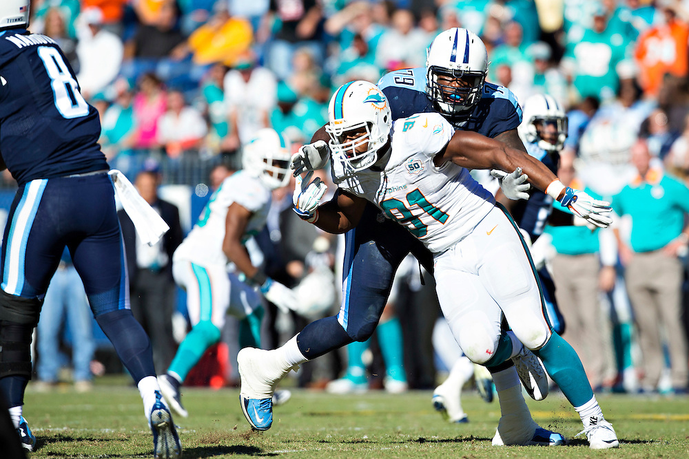 NASHVILLE, TN - OCTOBER 18:  Cameron Wake #91 of the Miami Dolphins rushes the quarterback and is blocked by Jamon Meredith #79 of the Tennessee Titans at LP Field on October 18, 2015 in Nashville, Tennessee.  The Dolphins defeated the Titans 38-10.  (Photo by Wesley Hitt/Getty Images) *** Local Caption *** Cameron Wake; Jamon Meredith