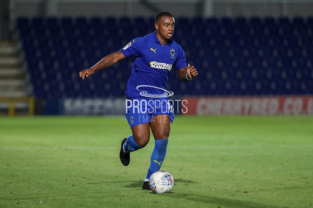 AFC Wimbledon defender Kyron Stabana (14) dribbling during the EFL Trophy (Leasing.com) match between AFC Wimbledon and U23 Brighton and Hove Albion at the Cherry Red Records Stadium, Kingston, England on 3 September 2019.