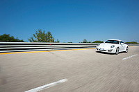 "19 August 2012.Photoreportage Nardò Techical Center Porsche Engineering ..NEWS ABOUT.Stuttgart/Nardò. In May 2012, the Porsche Engineering Group will be taking over responsibility for the Nardò Technical Center automotive proving ground in Apulia in southern Italy from Prototipo SpA. With more than 80 years experience in engineering services, the hundred per cent subsidiary of Dr. Ing. h.c. F. Porsche AG, Stuttgart, will be further optimising the test facilities and making them available to its clients for testing and trials purposes. Covering an area of more than 700 hectares, the test ground in the Province of Lecce comprises a 6.2 kilometre long handling circuit, a 12.5 kilometre long oval circuit and facilities for simulating different road surfaces and changeable weather conditions..""The Nardò proving ground with its high-speed and vehicle handling circuit ideally complements our facilities in Weissach. With the systematic development of the company in Nardò as part of Strategy 2018, Porsche is proving to be a reliable employer and business partner in Apulia as well,"" said Matthias Müller, President and CEO of Porsche AG..""With its rich array of facilities, from dynamic surfaces to acoustic and off-road sections coupled with the numerous workshops, our clients can continue to make extensive use of Nardò for their vehicle trials in the future as well,"" said Malte Radmann, CEO of Porsche Engineering. Thanks to the mild climate, the Nardò proving ground can be used throughout the year in three shifts around the clock, seven days a week..Together with the Porsche Development Centre in Weissach near Stuttgart, the Porsche Engineering Group has been offering Porsche's extensive development expertise as a service to its clients from the automotive industry and other sectors worldwide, from renting test rigs to developing complete vehicles.."