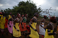 Samburu Dances, the Samburu people reside in the Rift Valley province of Northen Kenya., April 2005. Dancing is part of the Samburu culture which traditionally is accompanied by singing and hand clapping, musical instrumentts are not used. Two groups are formed, men who gather in a circle and jump to considerable hights from a standing position and women standing aside, although apart their movements are in perfect synchronization. Photo: Antonio Nodar/Imagenes Libres