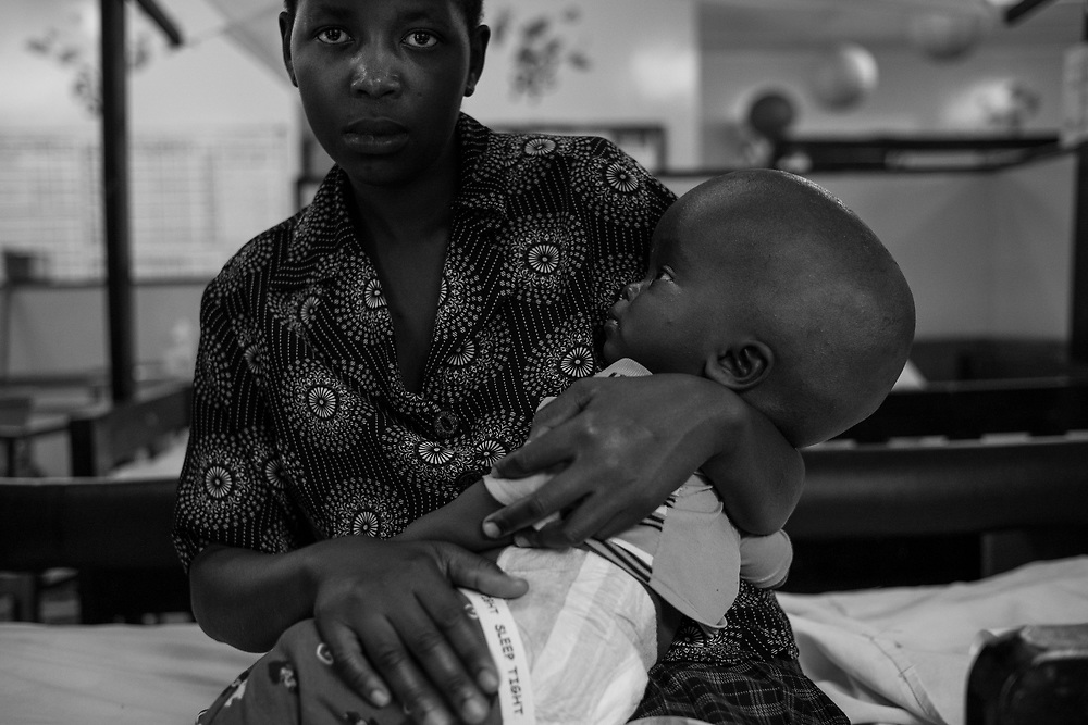 A mother with her son, who was diagnosed with Hydrocephalus at Cure Hospital on February 4, 2017 in Mbale, Uganda. There is no cure for the condition, only treatment.
