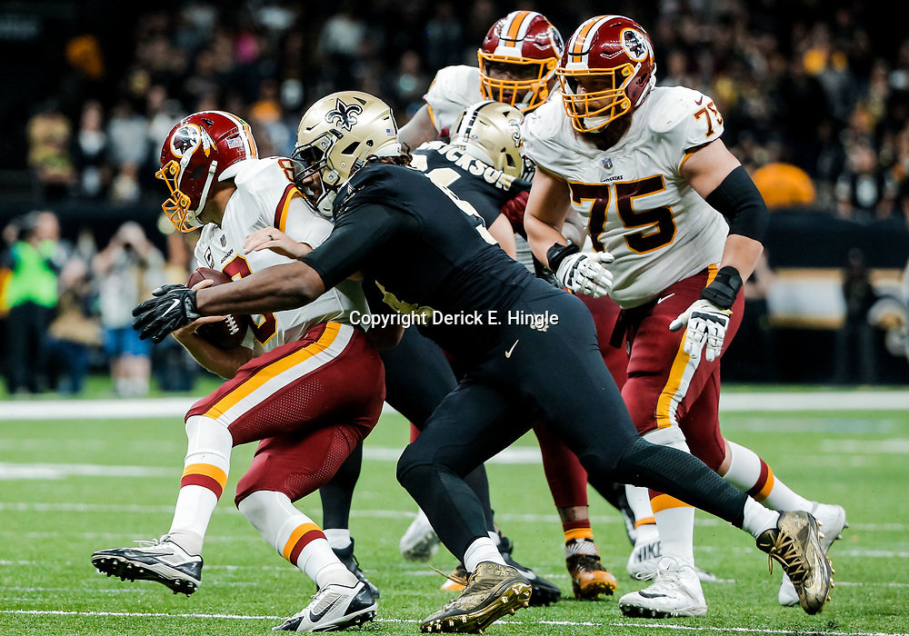 Nov 19, 2017; New Orleans, LA, USA; New Orleans Saints defensive end Cameron Jordan (94) sacks Washington Redskins quarterback Kirk Cousins (8) during overtime of a game at the Mercedes-Benz Superdome. The Saints defeated the Redskins 34-31 in overtime. Mandatory Credit: Derick E. Hingle-USA TODAY Sports